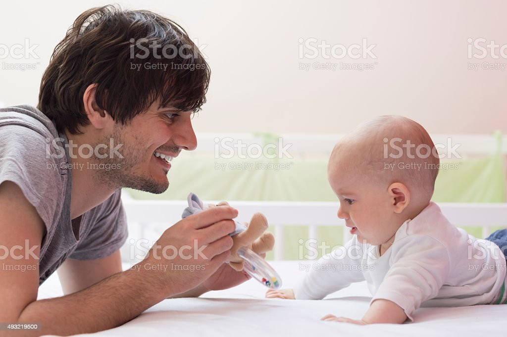 Playful father and son stock photo