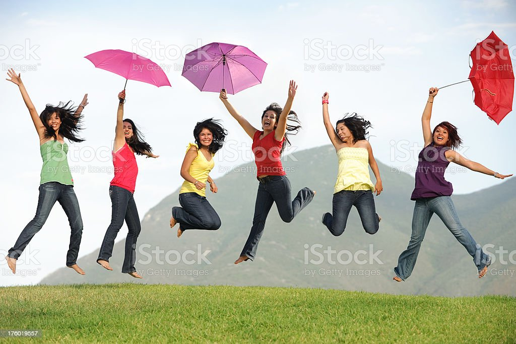 Playful friends jumping royalty-free stock photo
