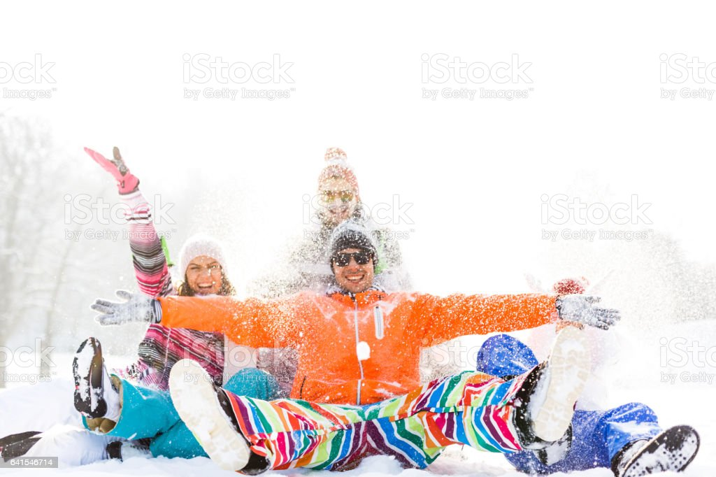 Playful friends on snow stock photo