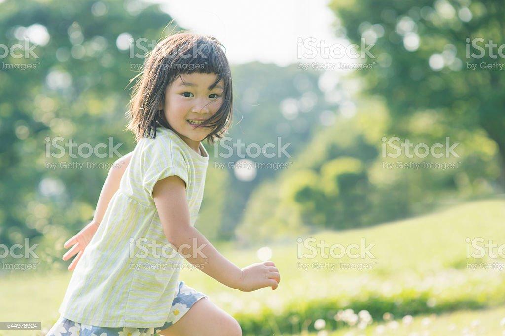 Playful girl having fun time in nature stock photo