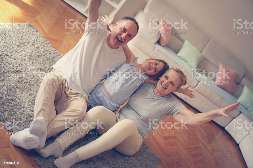 Playful grandparents with their granddaughter. stock photo