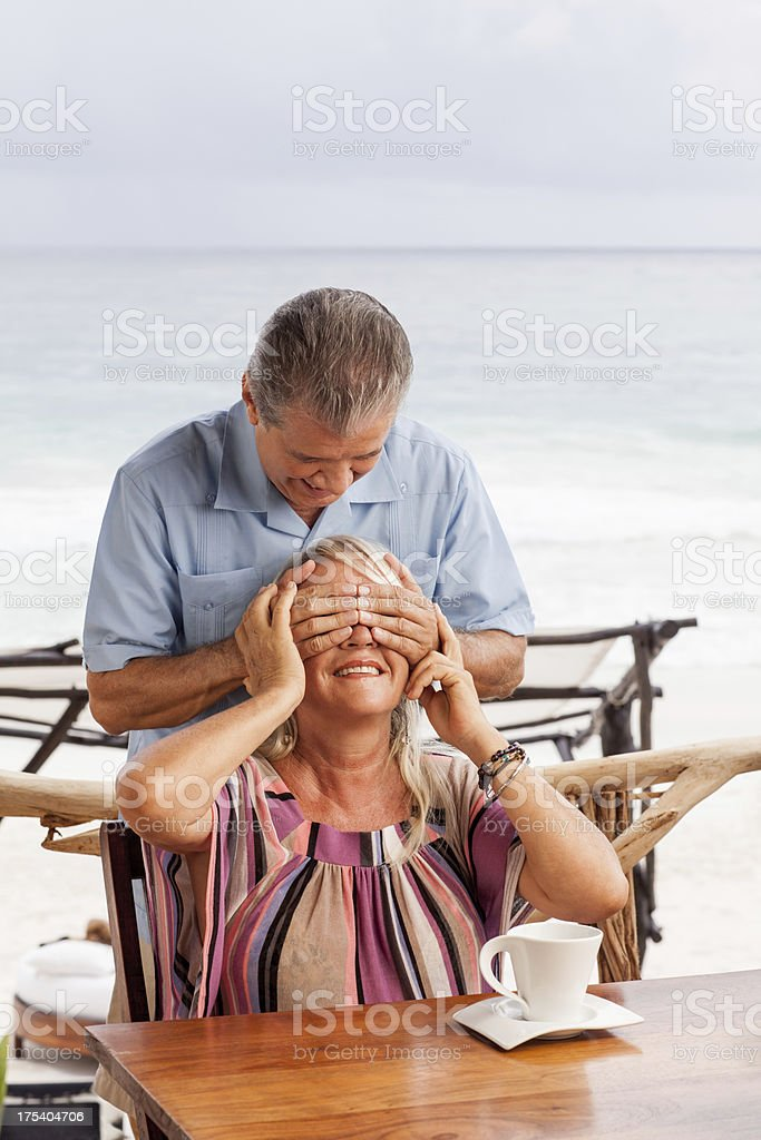 Playful husband surprising his wife royalty-free stock photo