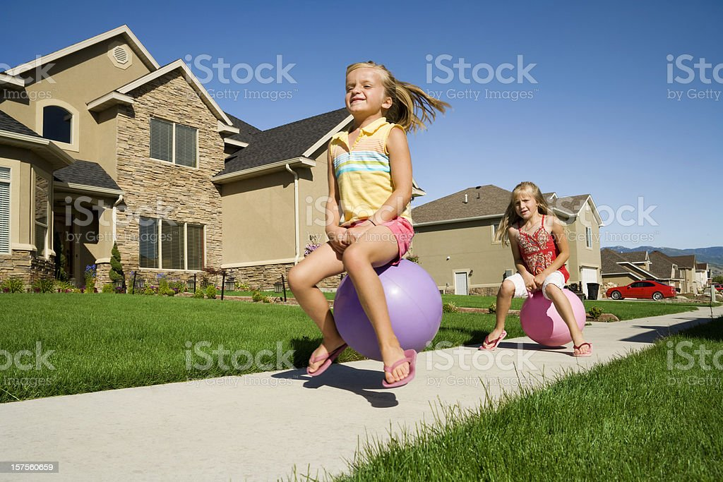 Playful Kids on Bouncy Toys stock photo
