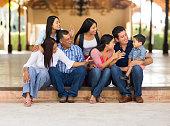 Playful latin family having fun
