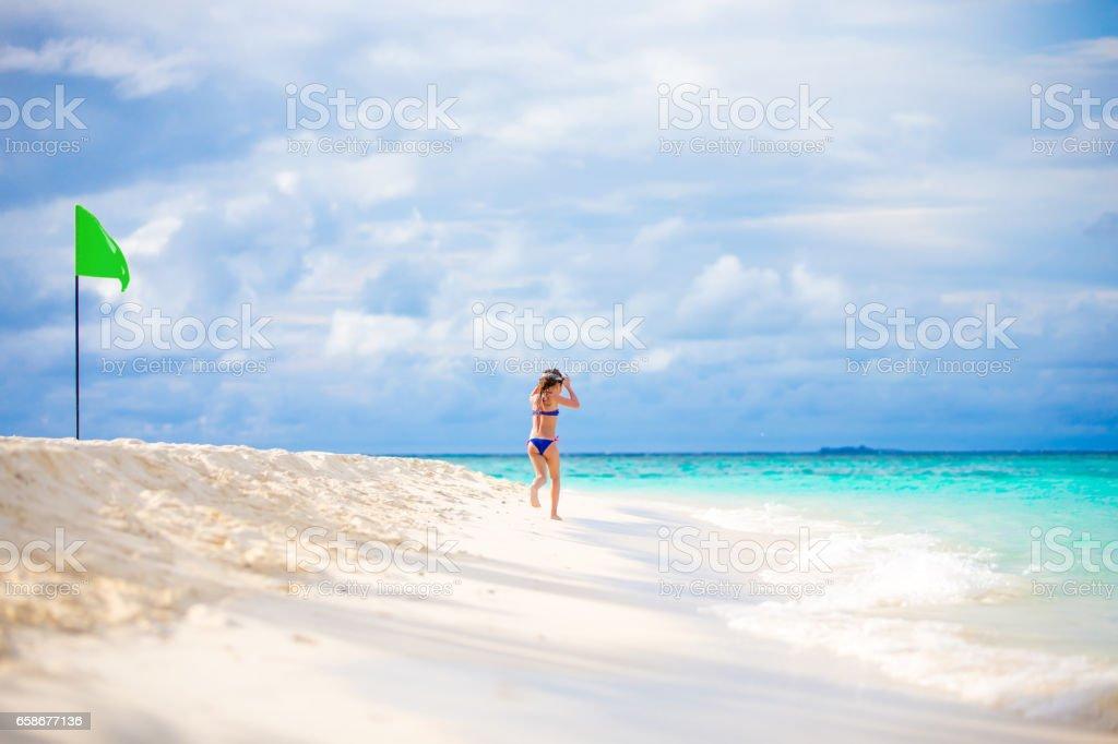 Playful Little Girl Enjoying On Maldivies Bech stock photo