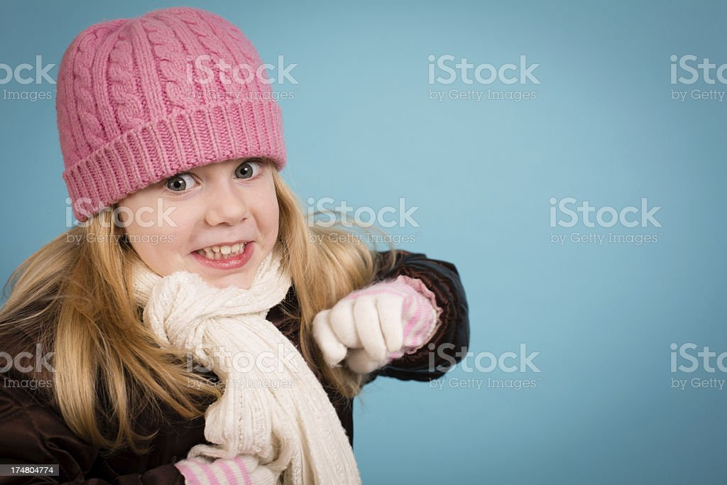 Playful Little Girl Wearing Hat and Scarf, With Copy Space royalty-free stock photo