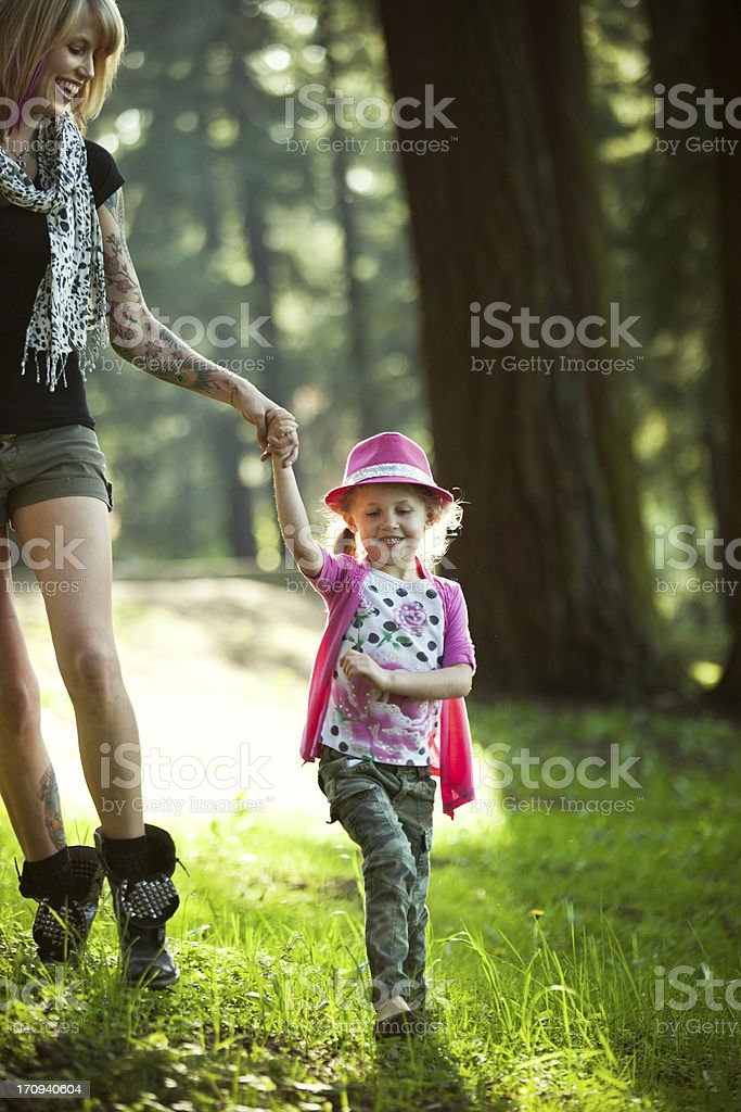 Playful Mom and Daughter on a Forest Hike royalty-free stock photo