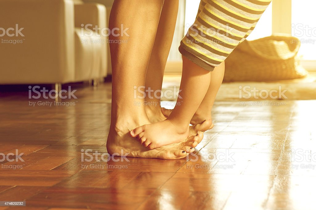 Playful mother and son feet stock photo