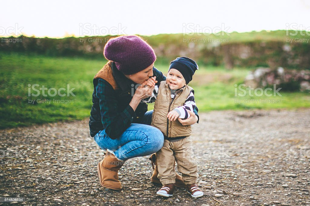 Playful mother and son stock photo