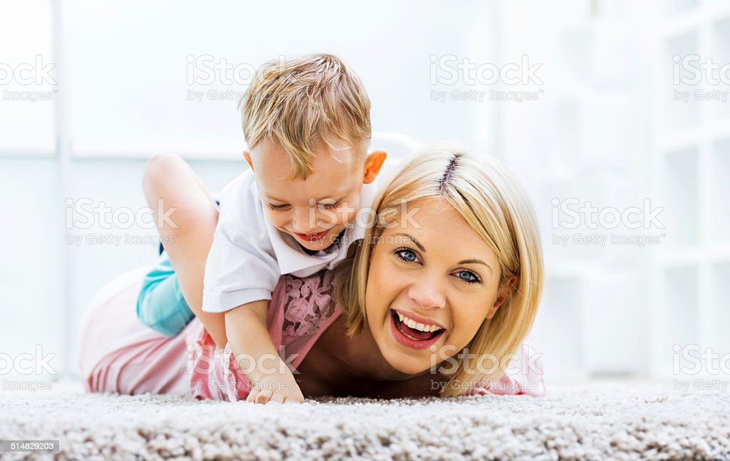 Playful mother and son. stock photo