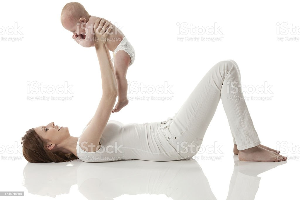Playful mother with her baby royalty-free stock photo