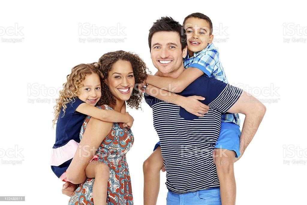 Playful parents giving children piggyback ride royalty-free stock photo