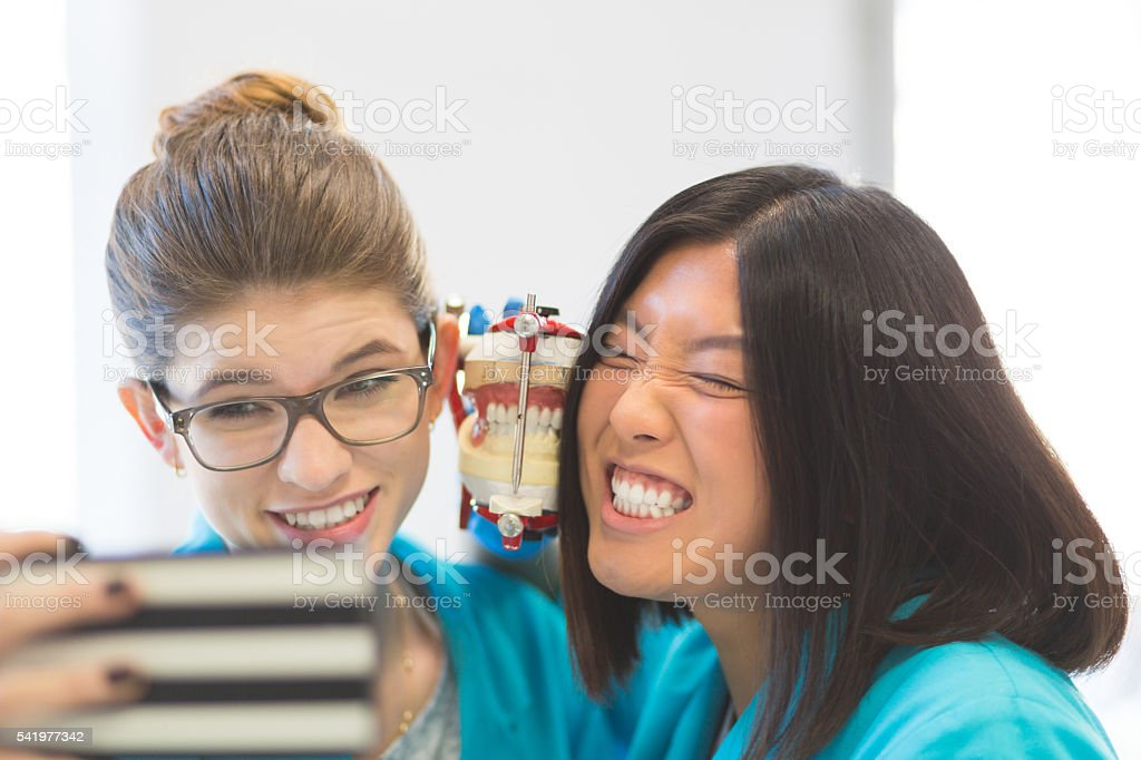 Playful prosthetic dentistry students taking selfie stock photo