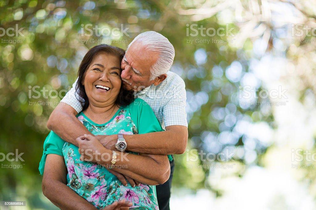 Playful senior couple having fun in the nature stock photo