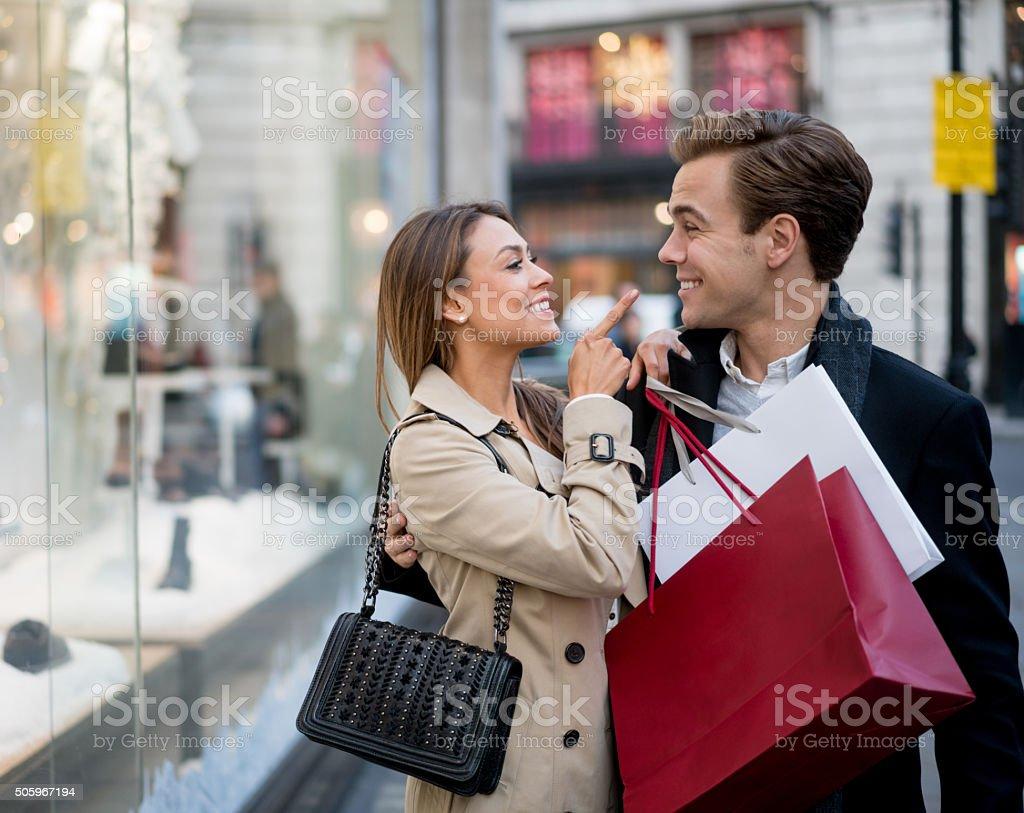 Playful shopping couple stock photo
