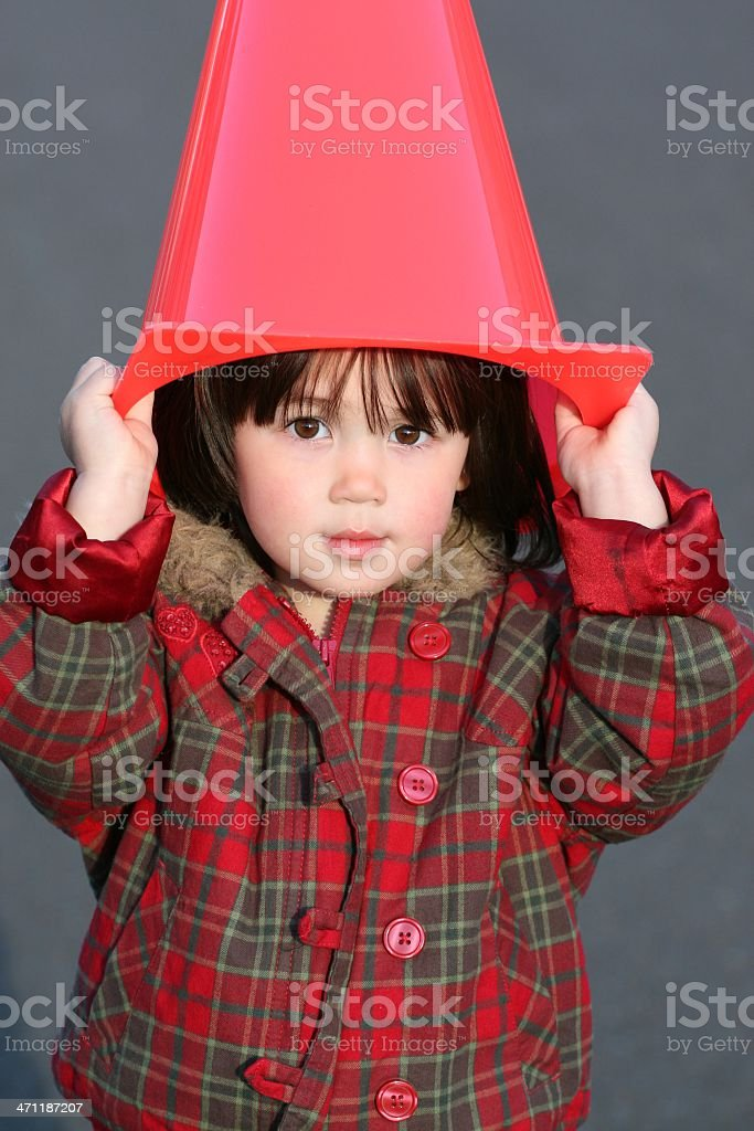 Playful Toddler with Traffic Cone royalty-free stock photo