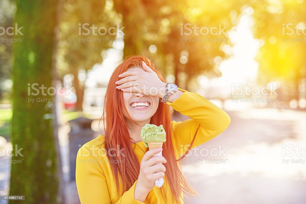 playful with her icecream stock photo