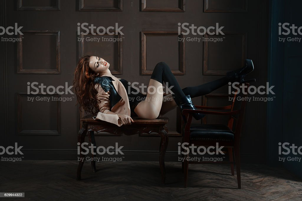Playful woman lying on the table. stock photo