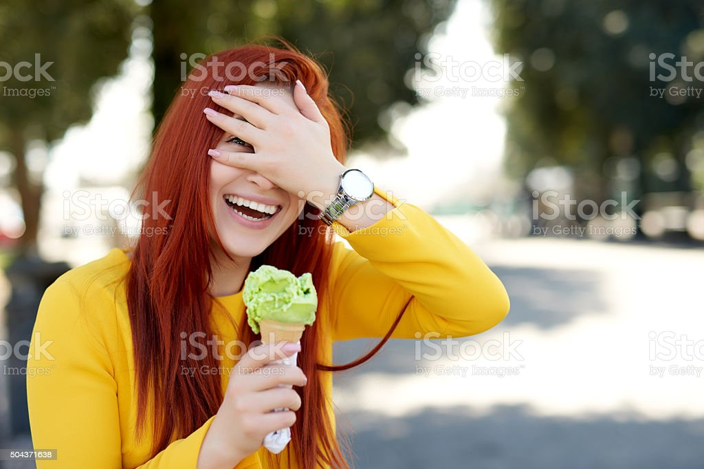 playful woman with her ice cream stock photo