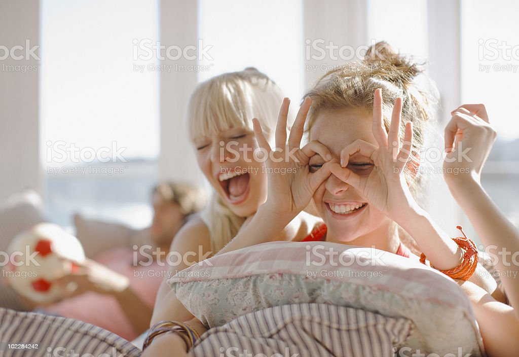 Playful women making faces royalty-free stock photo