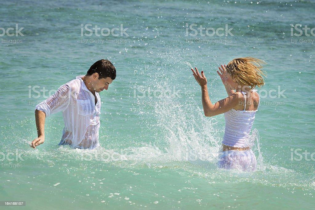 Playful young couple have a fun in tropical sea royalty-free stock photo