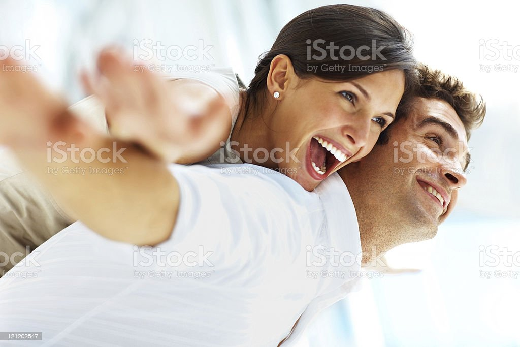 Playful young couple having fun royalty-free stock photo