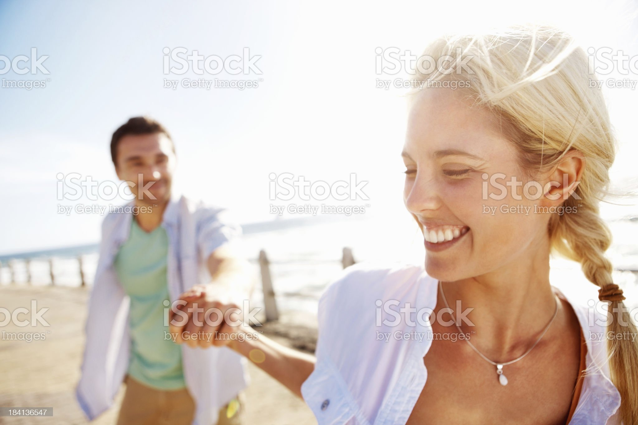 Playful young couple on pier royalty-free stock photo