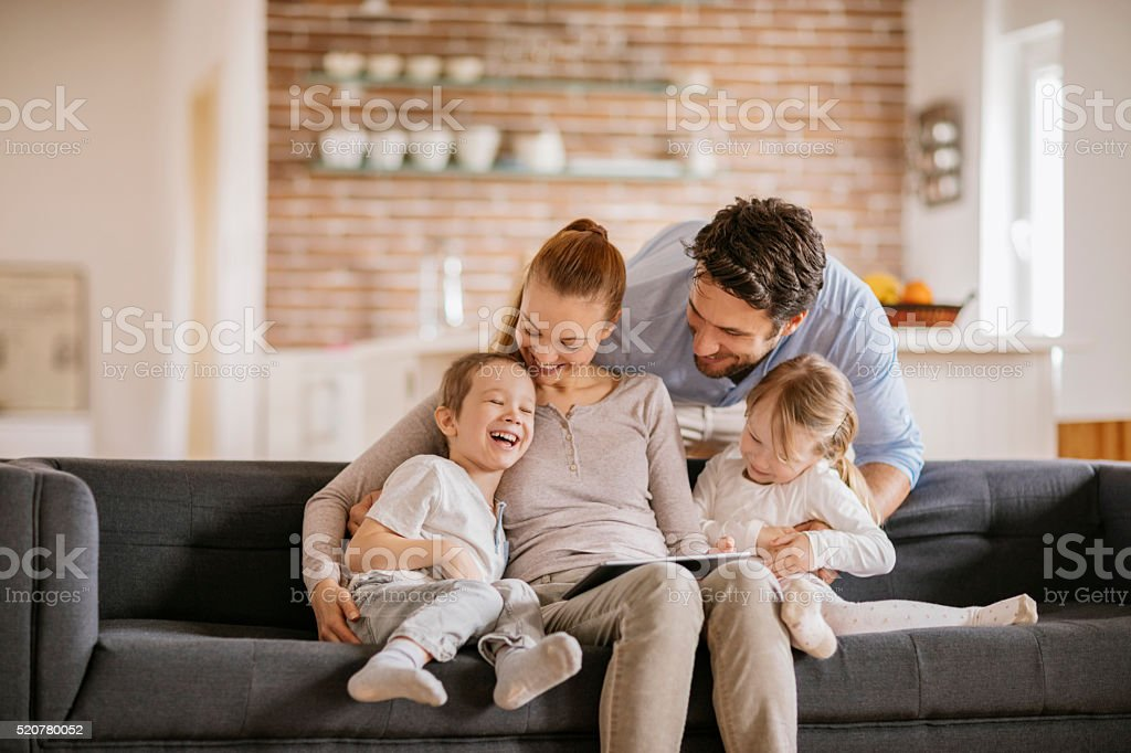 Playful young family stock photo