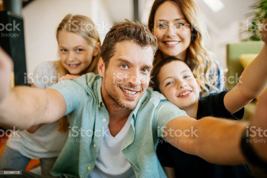 Playful young family taking a selfie stock photo