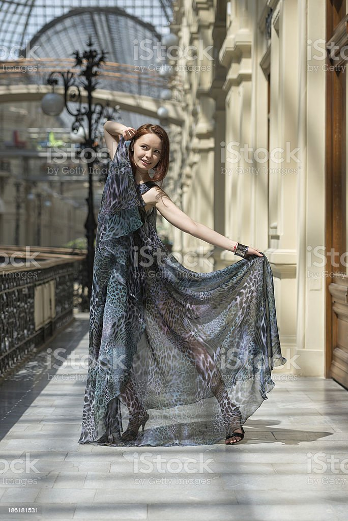 Playful young model in fashionable gauzy clothing royalty-free stock photo