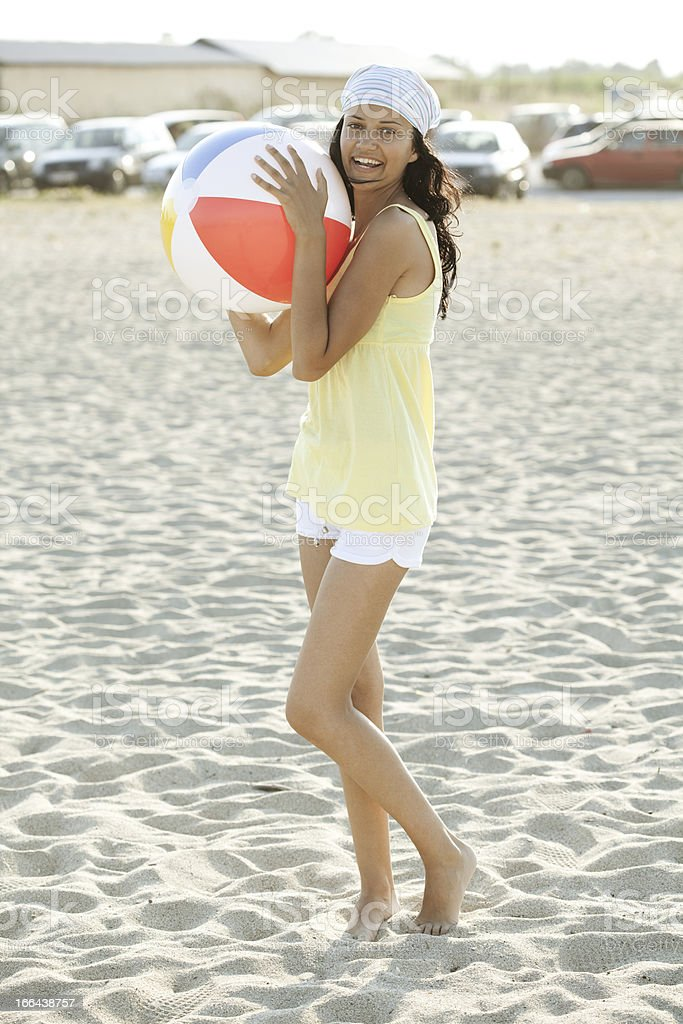 playful young woman at beach royalty-free stock photo