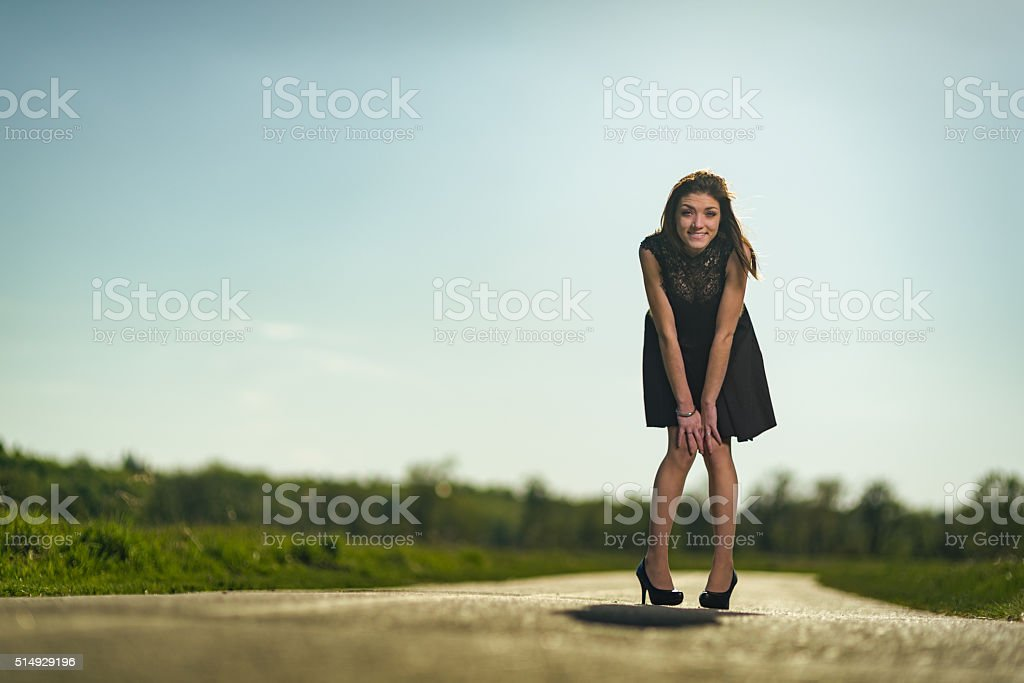 Playful young woman in park stock photo