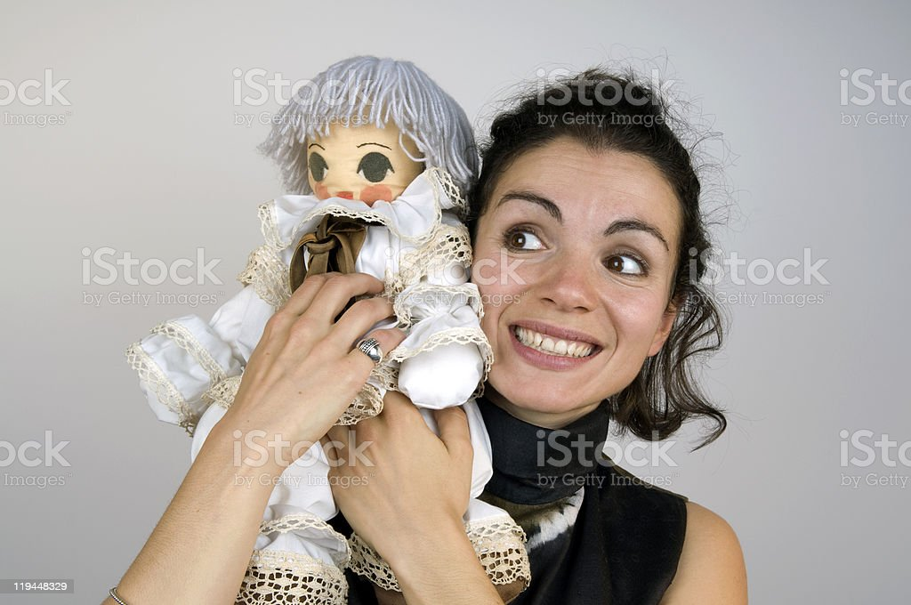Playful Young Woman With Puppet On Her Shoulders royalty-free stock photo