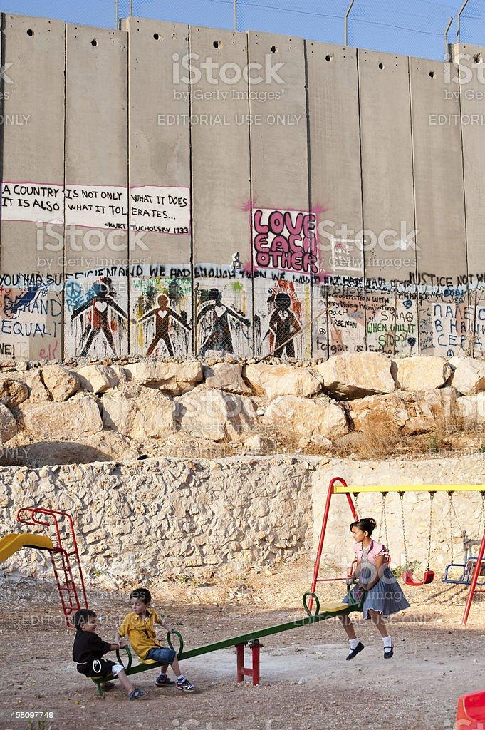 Playground and Israeli Separation Wall stock photo