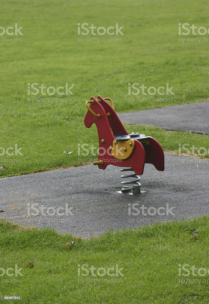 Playground Horse on spring stock photo