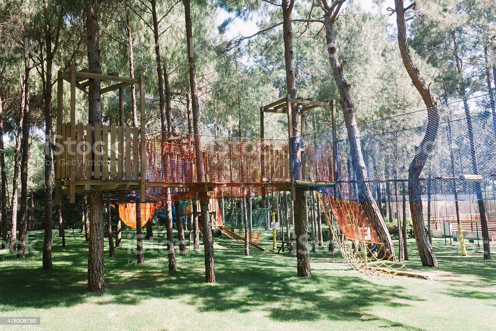 playground in forest, tourism travel destination stock photo