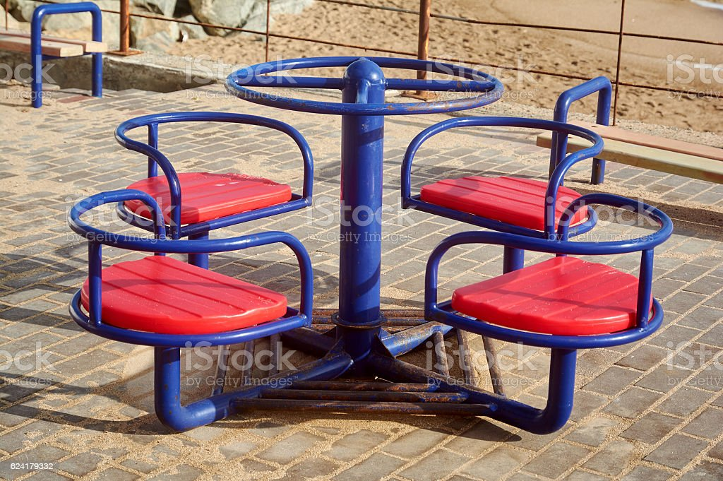 Playground merry-go-round. Carousel. stock photo