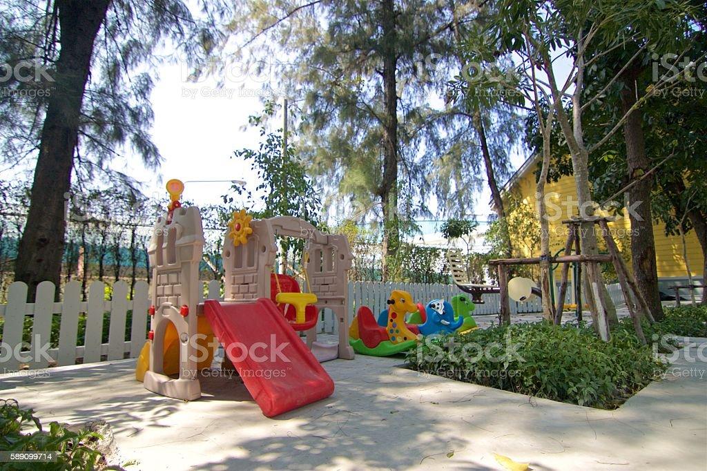 Playground near chemical factory stock photo