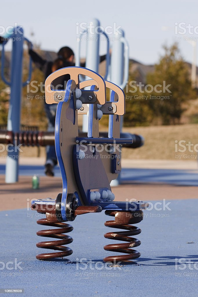 Playground rocking horse stock photo