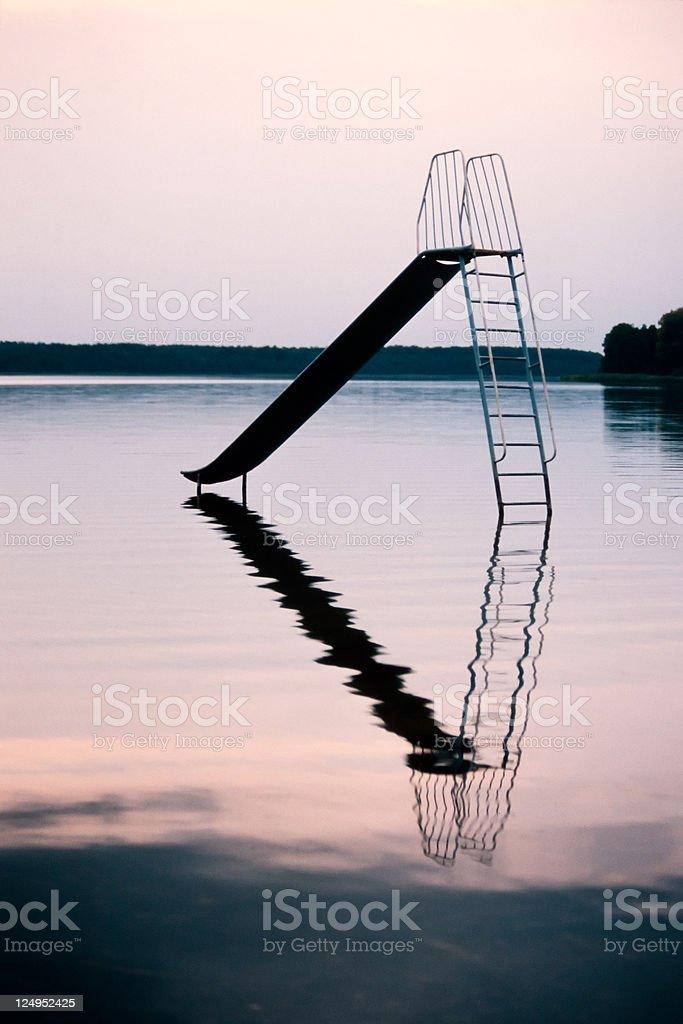 Playground Slide in Lake royalty-free stock photo