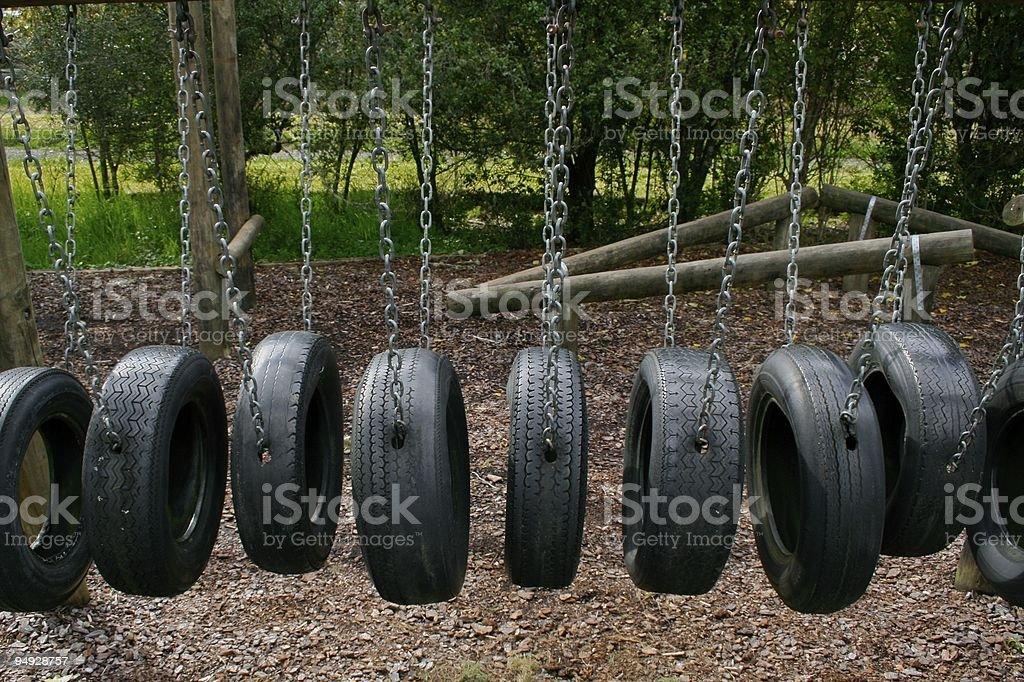 Playground tire bridge swing royalty-free stock photo