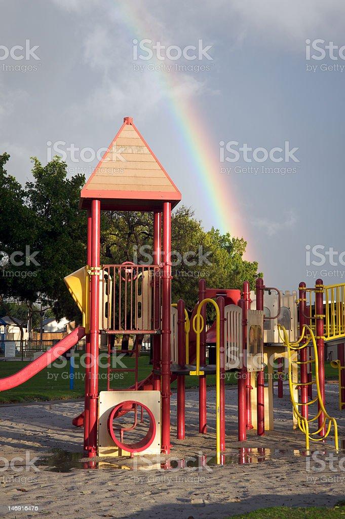 Playground with rainbow royalty-free stock photo