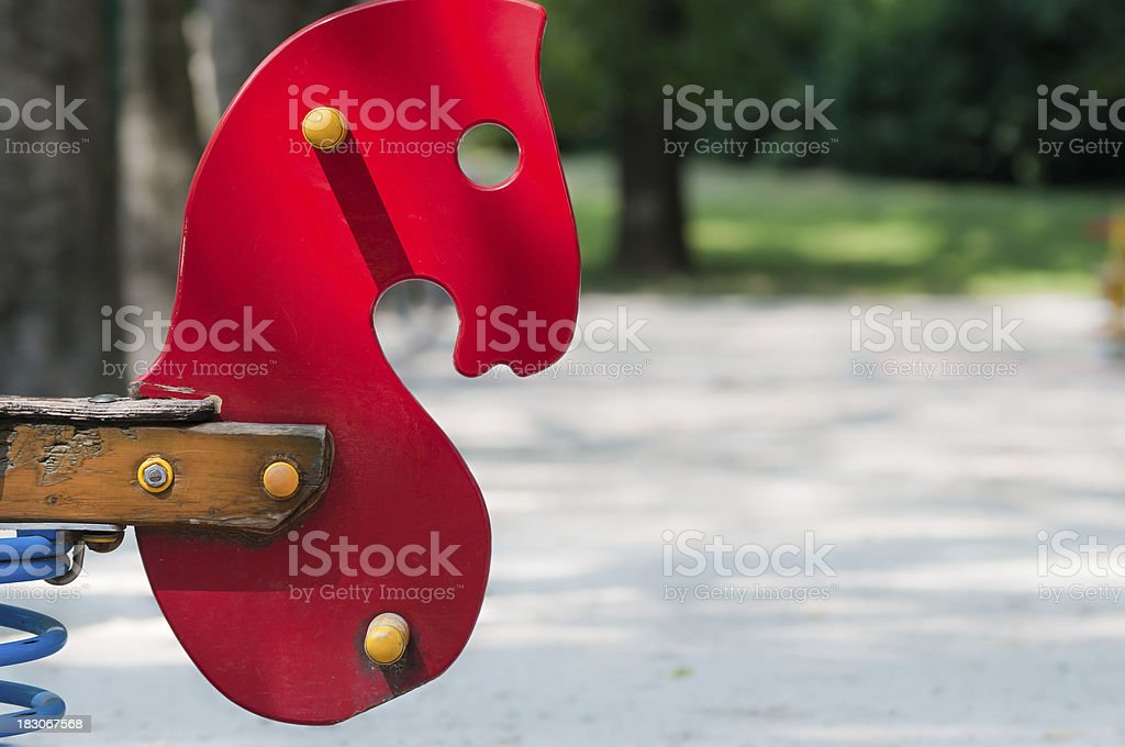 Playground's Red Rocking Horse's head stock photo