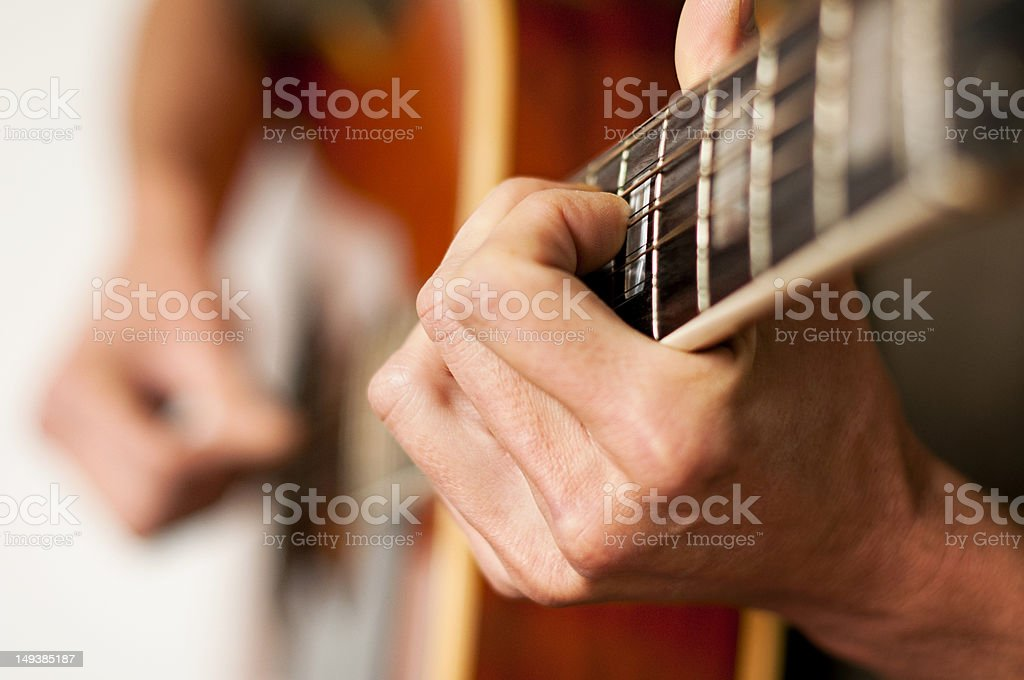 Playing a 12 string acoustic guitar stock photo