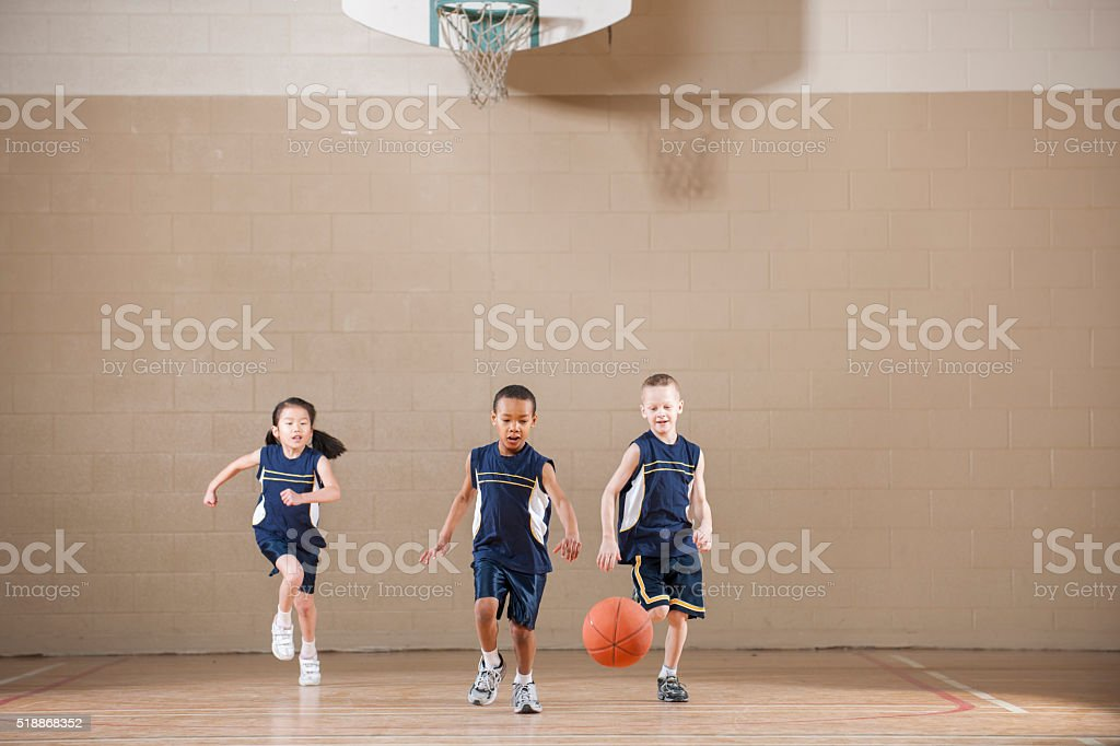 Playing a Basketball Game in the Gym stock photo