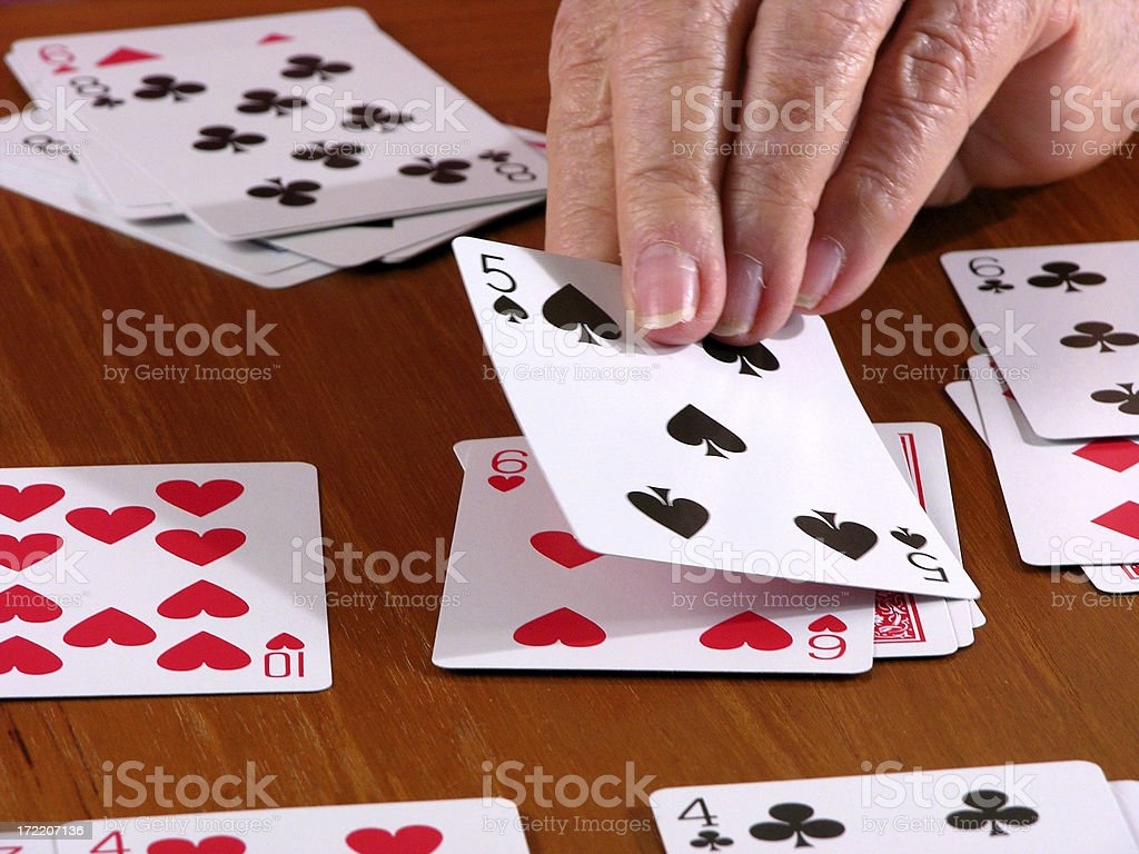 Playing a card stock photo