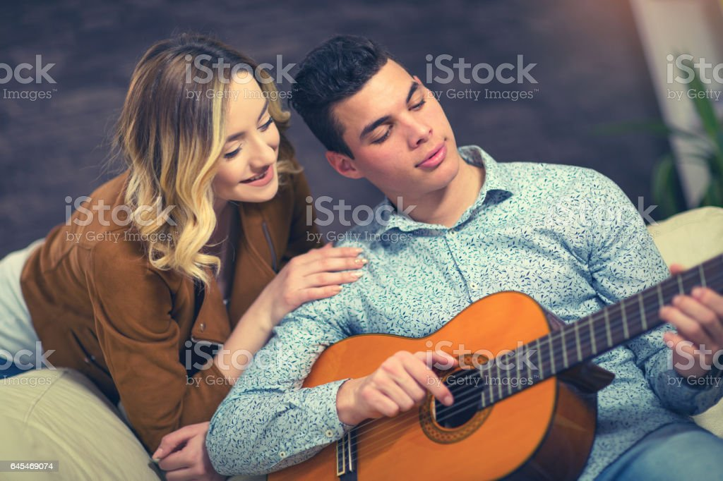 Playing a guitar stock photo