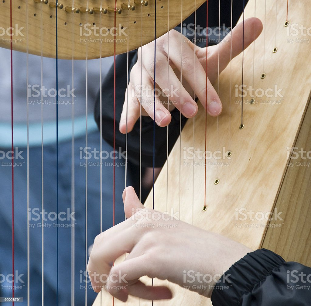 Playing a Harp royalty-free stock photo