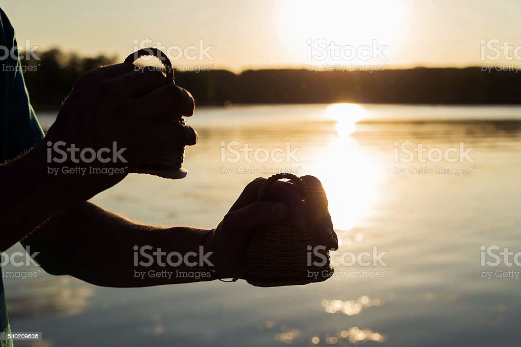 Playing a musical instrument maracas or caxixi stock photo