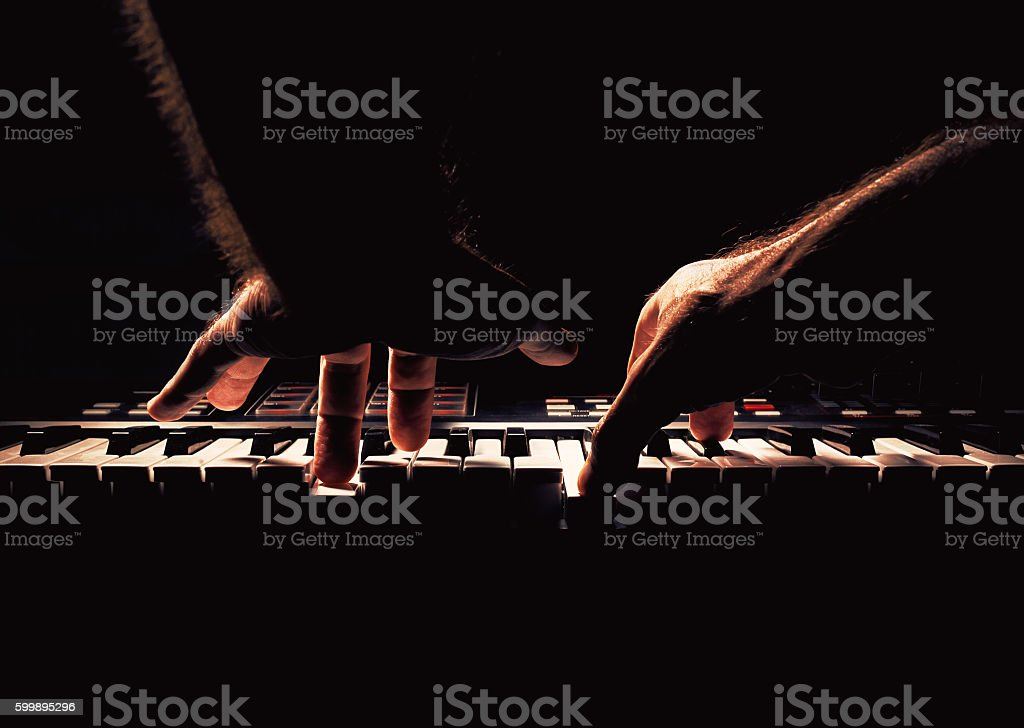 Playing a Piano or Synth stock photo